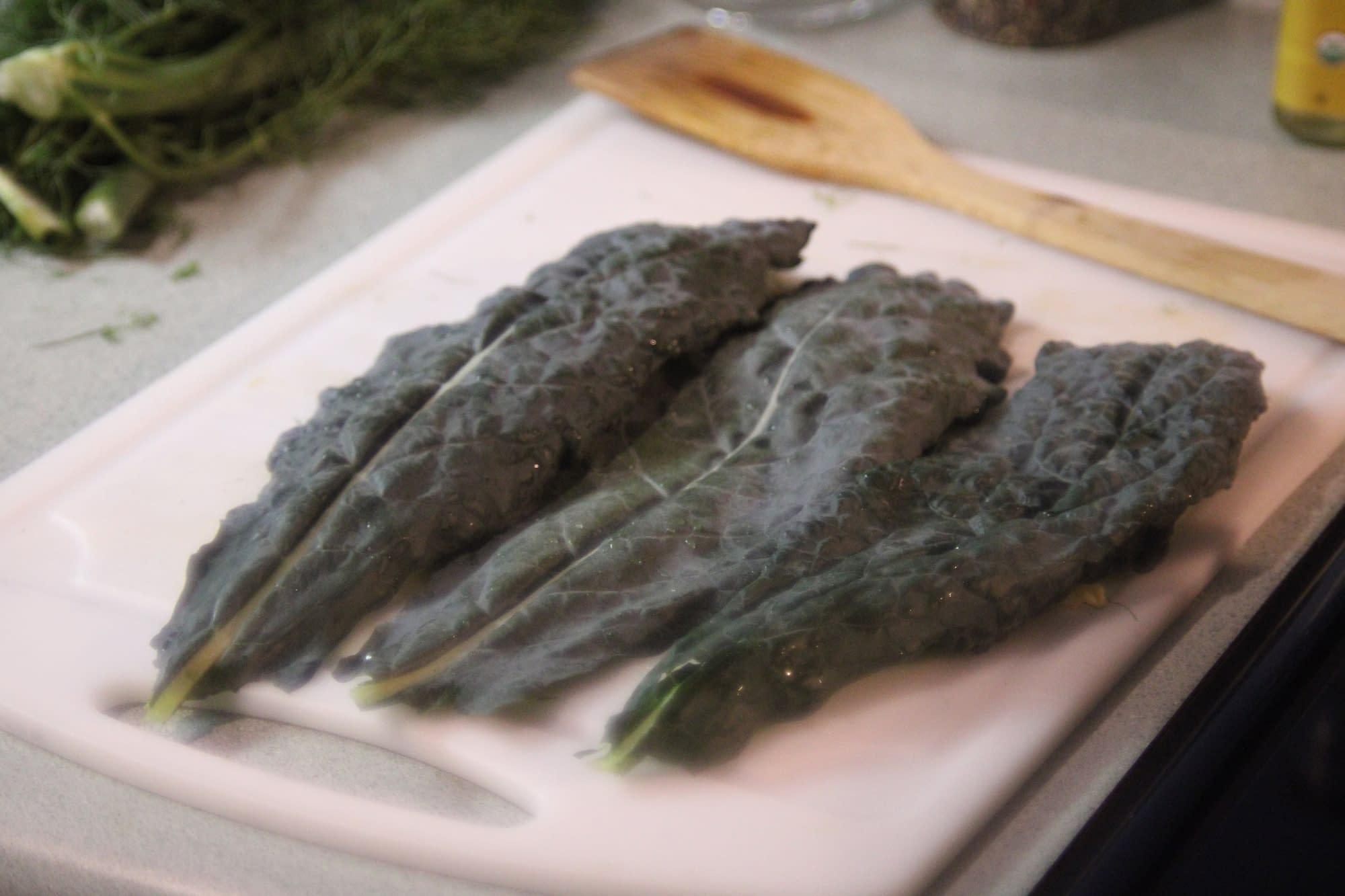 Kale on the cutting board.