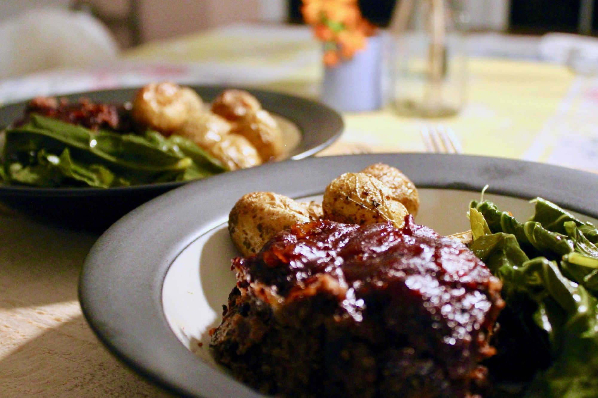 Tender vegan meatloaf from Savor + Harvest with Karl served at the table.