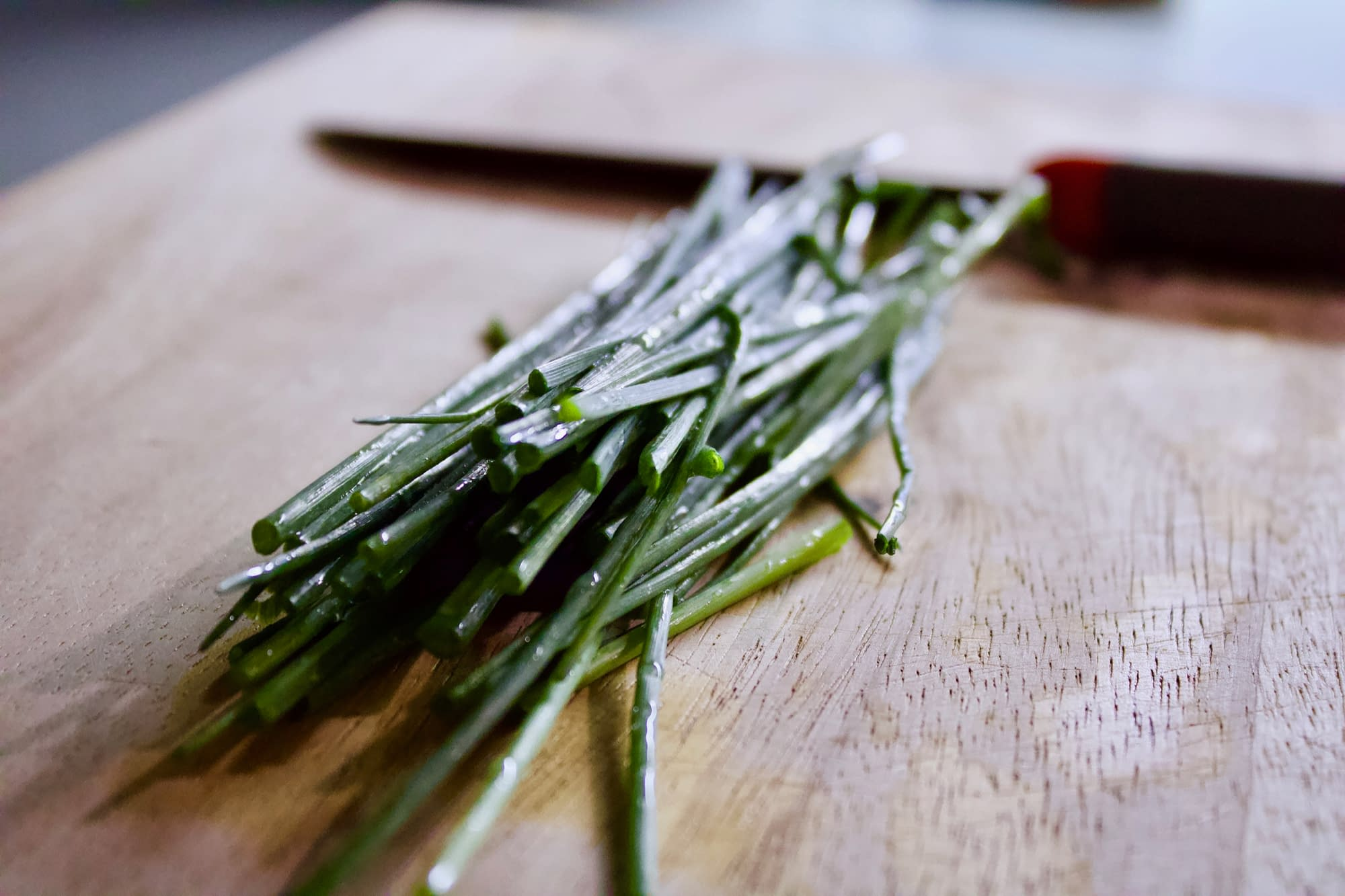 Chives on a cutting board.