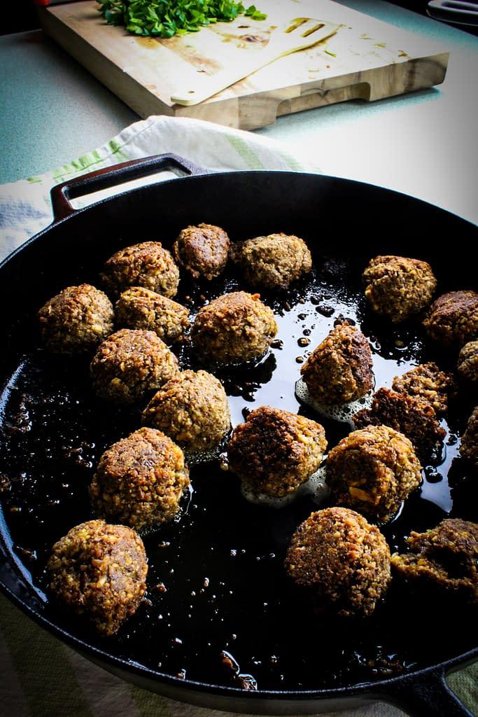 vegan meatballs in a cast iron pan.