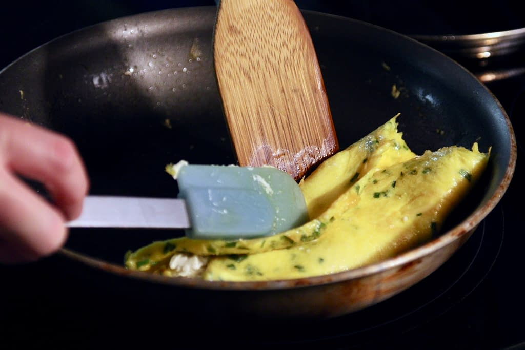 Folding other third of the french omelette.