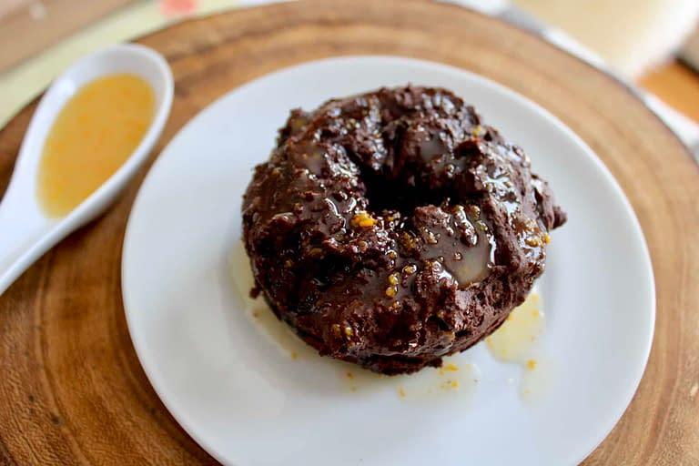 Chocolate glazed donuts with orange glaze.