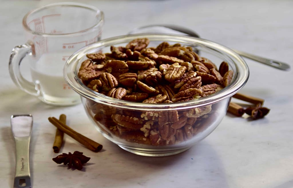 Ingredients for the cinnamon spiced candied nuts laid out on a countertop
