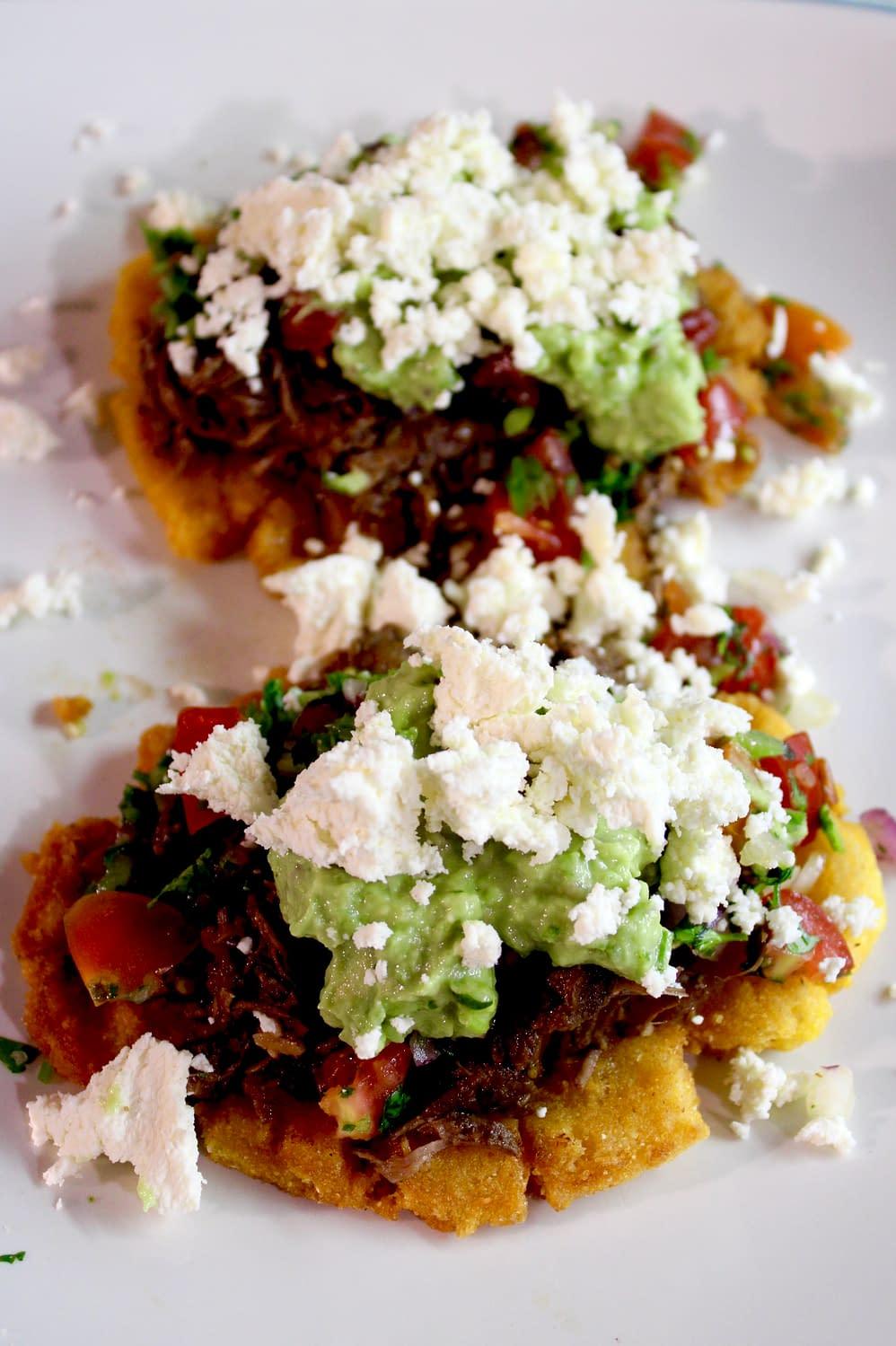 Slow-cooked beef cornbread tostadas